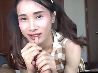 Cute pigtails and an asian ladyboy handjob POV style