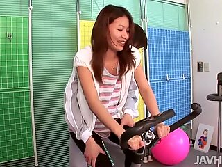 Tight brown haired chick Haruna Sakurai in yoga pants teases on cam