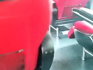 Masturbation on a bus, behind a stranger