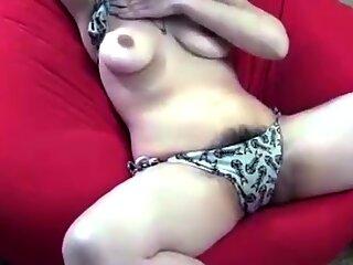 Showing her big hairy bush in bikini on sofa